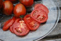 Salad Tomato Varieties—'Black Zebra' is a tart, purplish-black heirloom tomato with red stripes