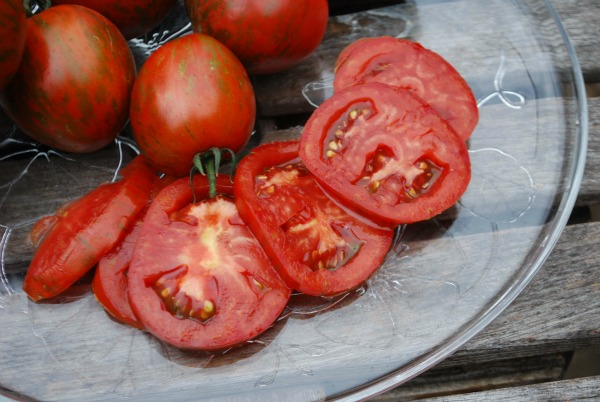 Salad Tomato Varieties—'Black Zebra' is a tart, purplish-black heirloom tomato with red stripes